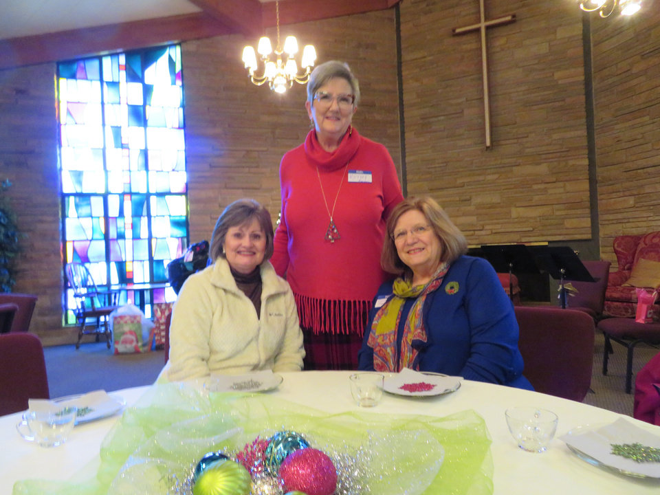 Photo -  CHRISTMAS TEA   Chapel Hill United Methodist Church women held an afternoon tea to celebrate Christmas and donations were accepted for local missions. Pictured are Melody McCreary, Kathy Pierson and Laura Clarkson. [PHOTO BY JOAN BRYANT]