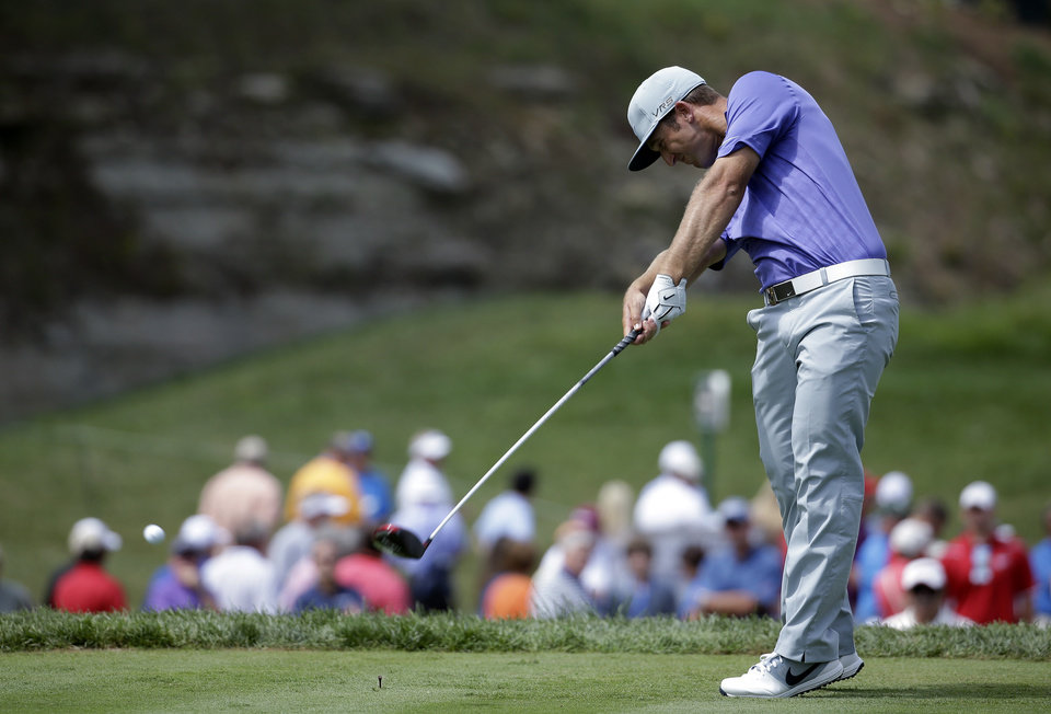 Photo - Kevin Chappell hits his tee shot on the 15th hole during the first round of the PGA Championship golf tournament at Valhalla Golf Club on Thursday, Aug. 7, 2014, in Louisville, Ky. (AP Photo/Jeff Roberson)