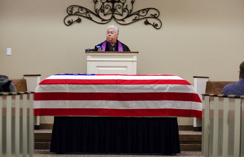Photo - Chaplin Becky Johnson officiates the funeral of homeless Army veteran William Eugene Weeks Jr., 64, at Chapel Hill Funeral Home in Oklahoma City, Okla. on Wednesday, Oct. 24, 2018.   Photo by Chris Landsberger, The Oklahoman