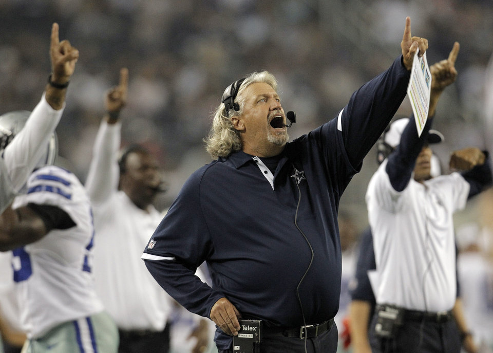 Dallas Cowboys defensive coordinator Rob Ryan and others point to the big screen against the St. Louis Rams during the second half of a preseason NFL football game, Saturday, Aug. 25, 2012 in Arlington, Texas. (AP Photo/Brandon Wade) ORG XMIT: CBS148