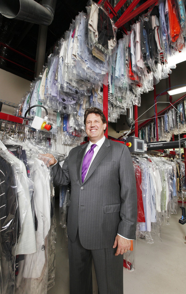 Photo - Edmond businessman Mark Neighbors, owner of the Parkway Cleaners and several other businesses along E 5 Street in Edmond, inside the Parkway Cleaners in Edmond on Wednesday.  PAUL B. SOUTHERLAND - The Oklahoman