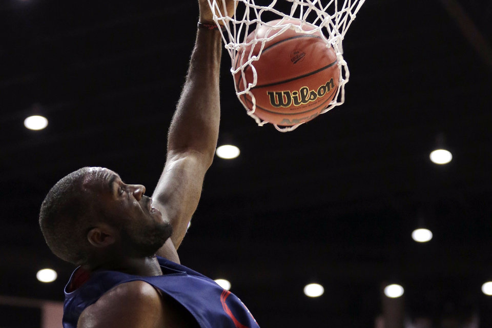 Photo - Gonzaga forward Sam Dower dunks during practice at the NCAA college basketball tournament Thursday, March 20, 2014, in San Diego. Gonzaga faces Oklahoma State in a second-round game on Friday. (AP Photo/Gregory Bull)