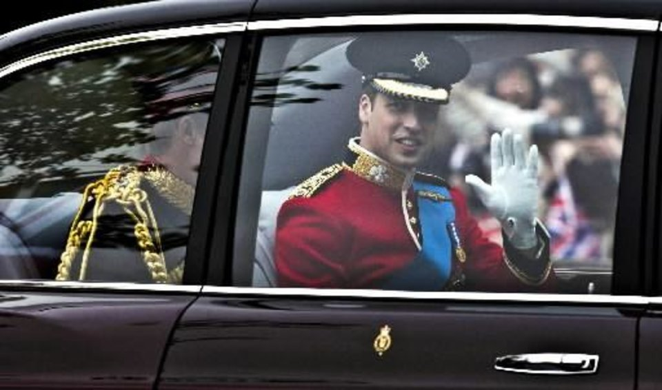 Photo - Britain's Prince William, right, travel with his brother Prince Harry in a Bentley to Westminster Abbey in London for his wedding to Kate Middleton Friday April 29, 2011. (AP Photo/Warren Allott, Pool)