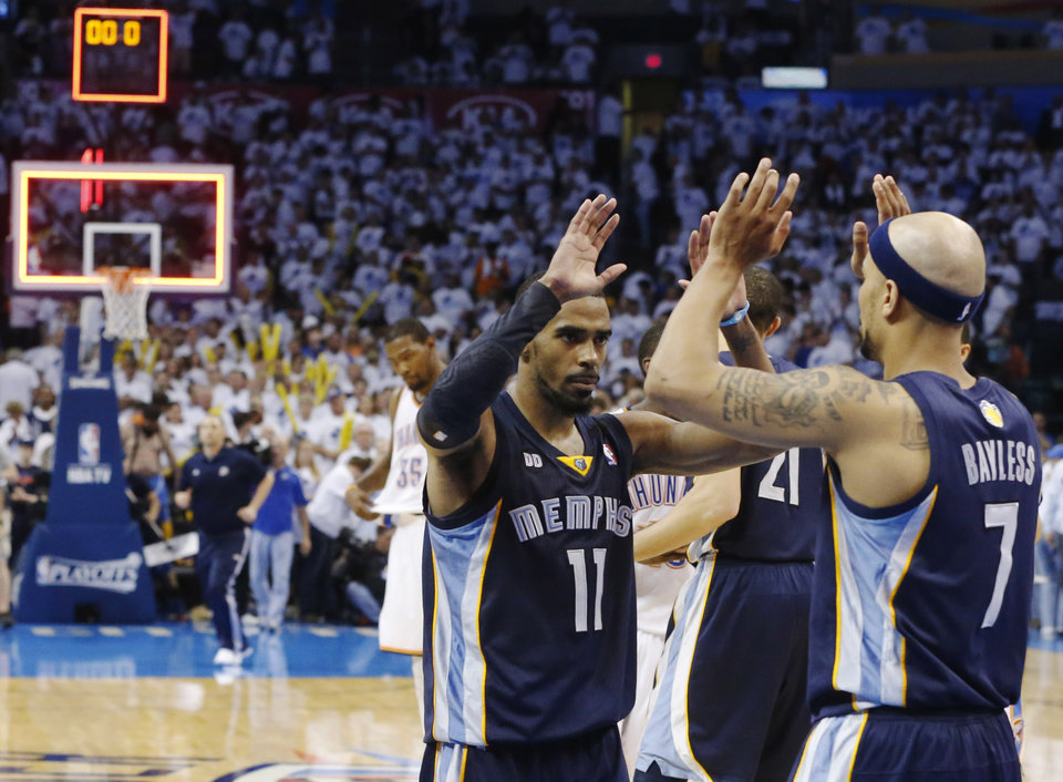 Photo - Memphis Grizzlies point guard Mike Conley (11) and Jerryd Bayless (7) celebrate at the end of Game 5 of their Western Conference Semifinals NBA basketball playoff series against the Oklahoma City Thunder in Oklahoma City, Wednesday, May 15, 2013. Memphis won 88-84. (AP Photo/Sue Ogrocki)