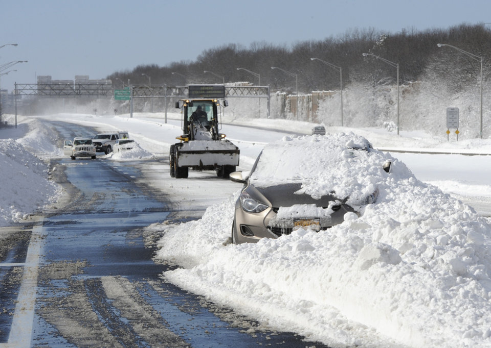 Photo - Abandoned cars on the Long Island Expressway after a snow storm on Saturday, Feb. 9, 2013 in Islandia, N.Y. (AP Photo/Kathy Kmonicek)