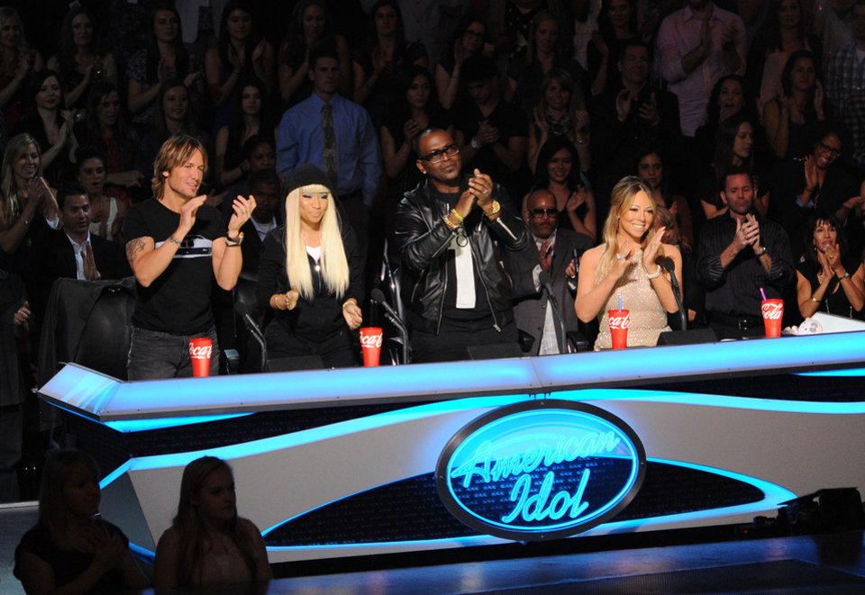 Photo - This undated image released by Fox shows judges, from left, Keith Urban, Nicki Minaj, Randy Jackson and Mariah Carey from the singing competition series,