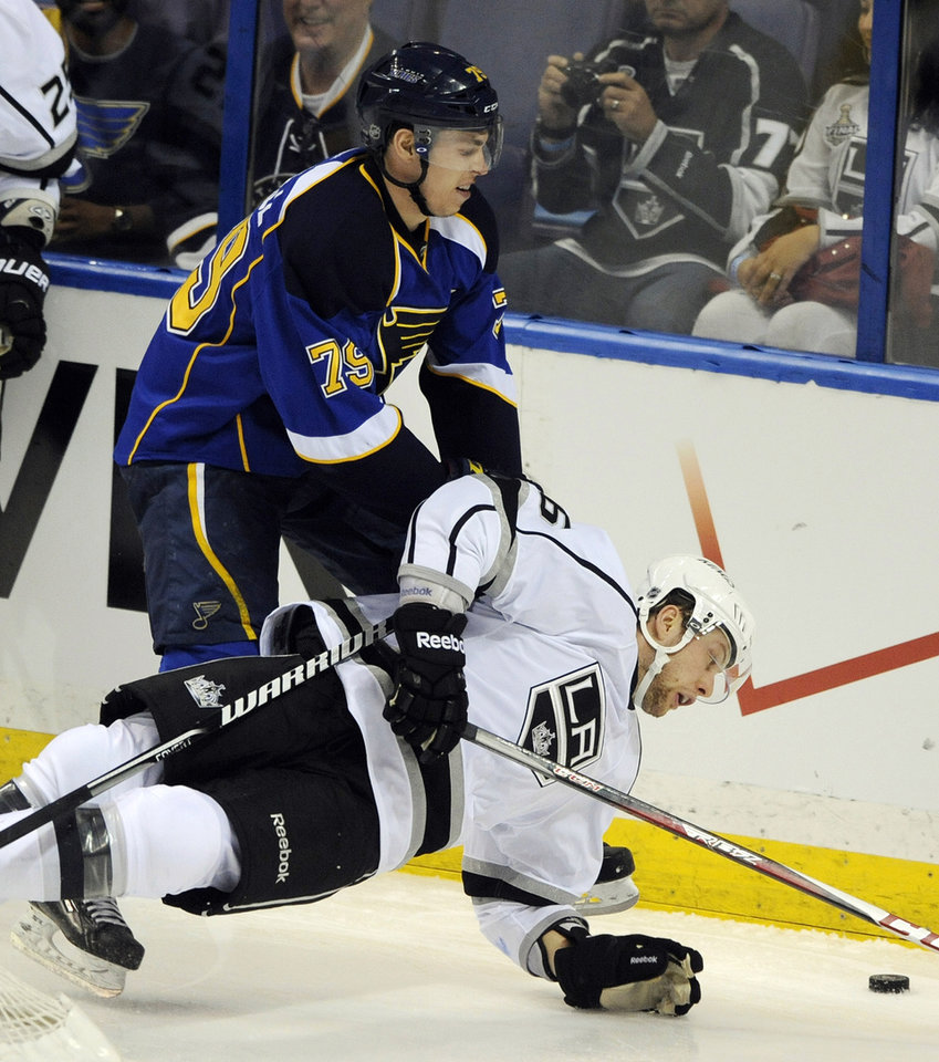 Photo - St. Louis Blues' Adam Cracknell (79) and  Los Angeles Kings' Jake Muzzin, right, compete for the puck during the second period of Game 1 of their first-round NHL hockey Stanley Cup playoff series, Tuesday, April 30, 2013, in St. Louis. (AP Photo/Bill Boyce)