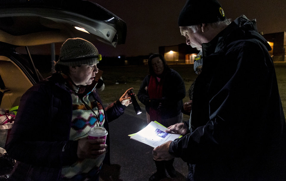 Photo - Amy Newberry and Bob Mann look over the map as they visit homeless camps to  interview members of the homeless population during the city's annual Point-in-Time homeless count in Oklahoma City, Okla. on Thursday, Jan. 23, 2020.   [Chris Landsberger/The Oklahoman]