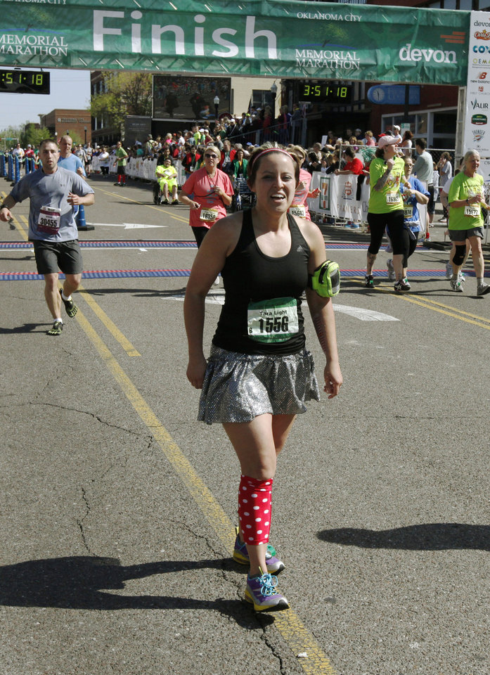 Photo - Tara Light wears a skirt as she finishes the Oklahoma City Memorial Marathon in Oklahoma City, Sunday, April 28, 2013,  By Paul Hellstern, The Oklahoman
