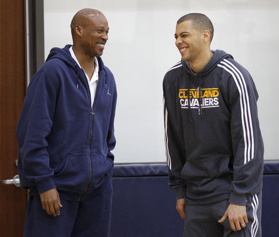 Photo -   Cleveland Cavaliers' Anthony Parker, right, shares a laugh with head coach Byron Scott following his end of season talk with the coach at the team's practice facility in Independence, Ohio, on Friday, April 27, 2012. (AP Photo/Amy Sancetta)