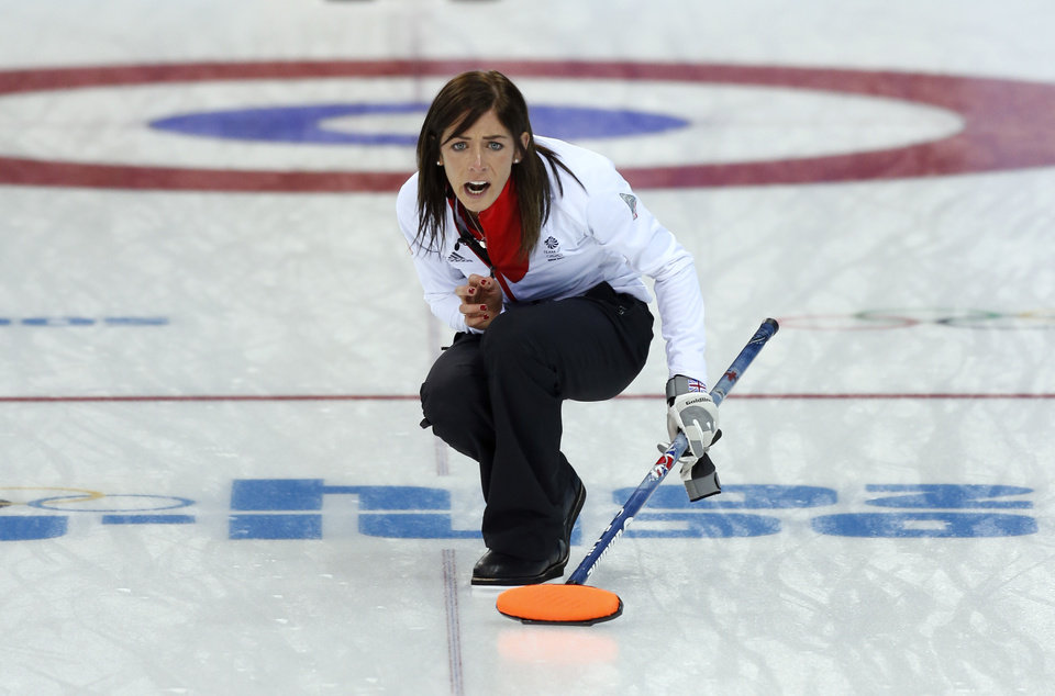 Photo - Great Britain's skip Eve Muirhead shouts instructions to her sweepers after delivering the rock in during women's curling competition against Canada at the 2014 Winter Olympics, Wednesday, Feb. 12, 2014, in Sochi, Russia. (AP Photo/Robert F. Bukaty)
