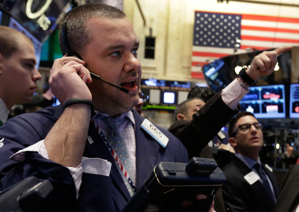 Photo - Trader Kevin Lodewick works on the floor of the New York Stock Exchange Tuesday, Feb. 4, 2014. Stocks are mixed on Wall Street after suffering big losses the day before. (AP Photo/Richard Drew)
