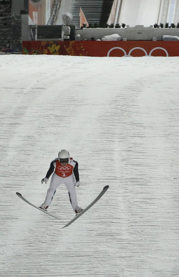 Photo - United States' Nicholas Alexander makes the first official jump during a men's normal hill ski jumping training at the 2014 Winter Olympics, Thursday, Feb. 6, 2014, in Krasnaya Polyana, Russia. (AP Photo/Gregorio Borgia)