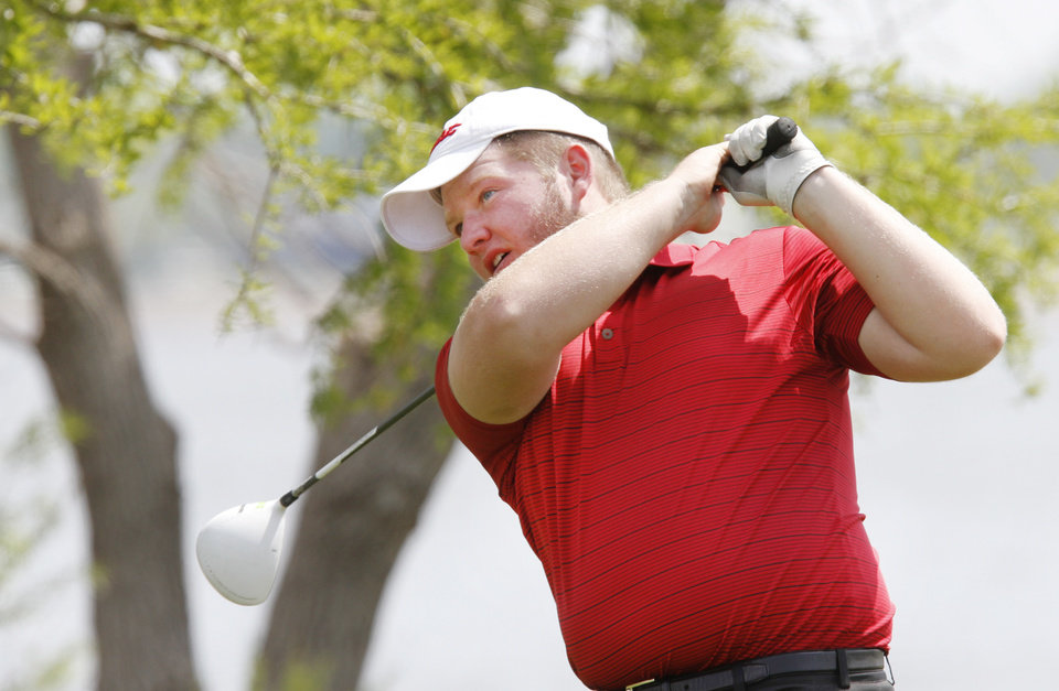 Photo - Hilldale's Brent LaCrone watches his tee shot during the 4A state golf tournament at Lake Hefner golf course in Oklahoma City , Monday May 6, 2013. Photo By Steve Gooch, The Oklahoman