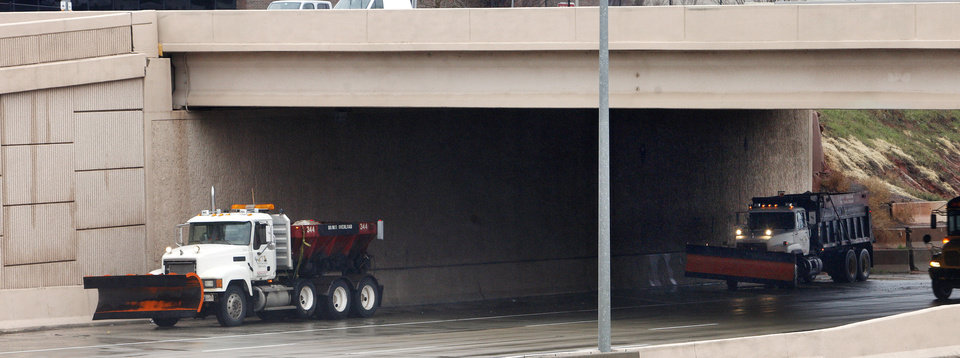 Two snow plows stage underneath the 63 Street bridge on the Broadway Extension while waiting for the weather to worsen in Oklahoma City Monday, Feb. 25, 2013. Photo by Paul B. Southerland, The Oklahoman