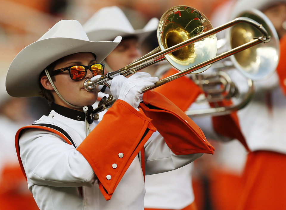 Photo - The OSU Cowboy Marching Band performs  before a college football game between the Oklahoma State Cowboys (OSU) and the Texas Tech Red Raiders at Boone Pickens Stadium in Stillwater, Okla., Thursday, Sept. 25, 2014. Photo by Nate Billings, The Oklahoman