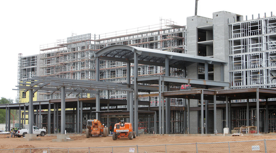 Photo -  An Embassy Suites is under construction at NE 7 and Phillips Avenue in Oklahoma City. Photo by Paul B. Southerland, The Oklahoman   PAUL B. SOUTHERLAND