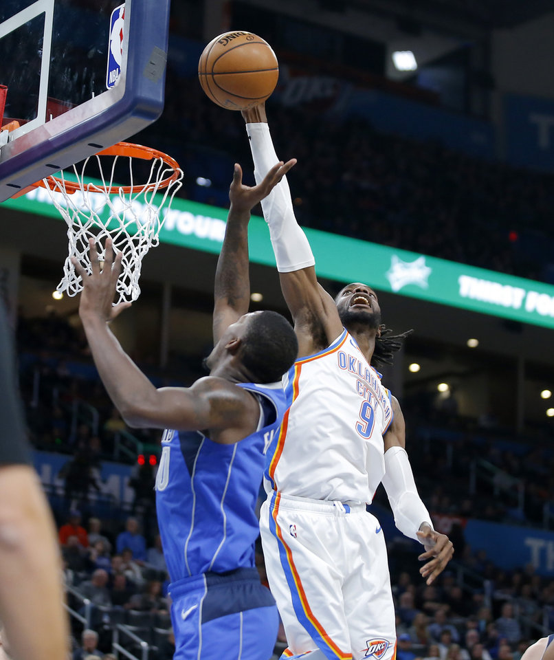 Photo - Oklahoma City's Nerlens Noel (9) blocks the shot of Dorian Finney-Smith (10) of Dallas during an NBA basketball game between the Oklahoma City Thunder and the Dallas Mavericks at Chesapeake Energy Arena in Oklahoma City, Tuesday, Dec. 31, 2019. Oklahoma City won 106-101. [Bryan Terry/The Oklahoman]