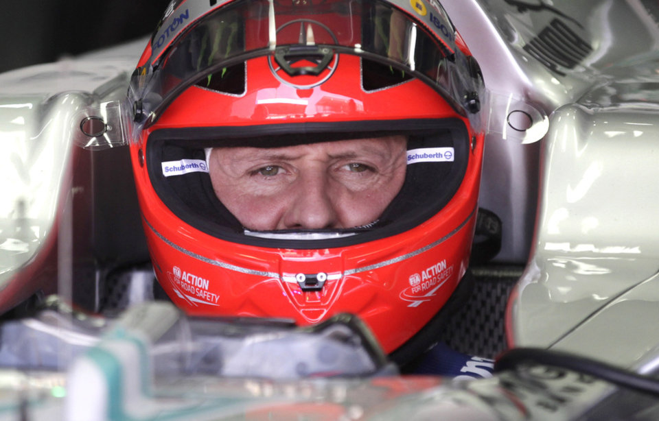 Photo - FILE - In this Nov. 23, 2012 file photo, Grand Prix driver Michael Schumacher, of Germany, sits in his car during a free practice at the Interlagos race track in Sao Paulo, Brazil.  Formula One great Michael Schumacher is no longer in a coma and has left a French hospital where he had been receiving treatment since a skiing accident in December, his manager said Monday June 16, 2014. (AP Photo/Victor Caivano, File)
