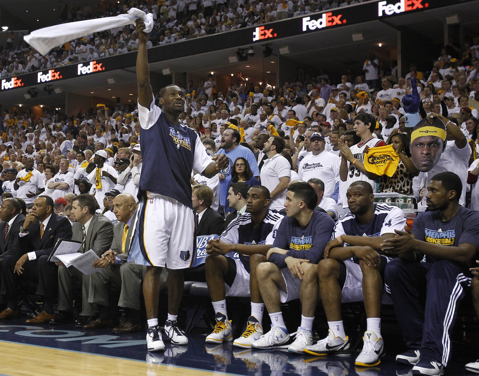 Photo - Memphis Grizzlies guard Tony Allen waves a towel as he cheers with the fans in the final minutes of the second half of Game 6 against the Oklahoma City Thunder in a second-round NBA basketball playoff series on Friday, May 13, 2011, in Memphis, Tenn. The Grizzlies won 95-83 to even the series 3-3. (AP Photo/Wade Payne)