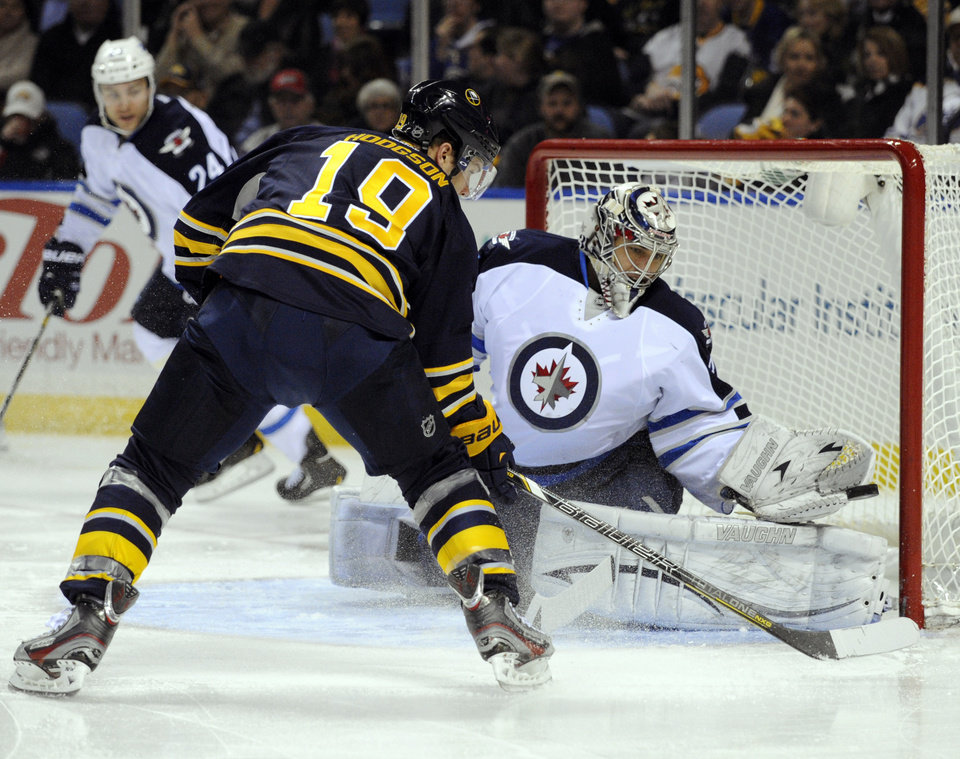 Buffalo Sabres'  center Cody Hodgson (19) shoots against Winnipeg Jets goaltender Ondrej Pavelec, (31), of the Czech Republic, during the first period of an NHL hockey game in Buffalo, N.Y., Tuesday, Feb. 19, 2013. (AP Photo/Gary Wiepert)