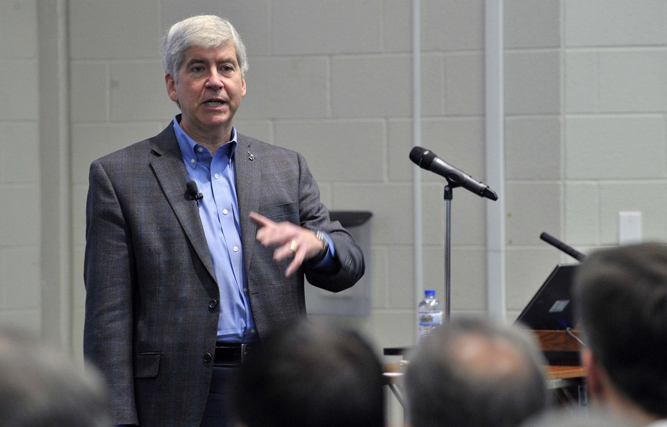 Governor Rick Snyder presents his views on Michigan's future energy plans and how they merge with environmental and resource management issues at MSU's WK Kellogg Biological Station, Wednesday, Nov. 28, 2012 near Hickory Corners, Mich. (AP Photo/Detroit News, Dale G. Young) DETROIT FREE PRESS OUT; HUFFINGTON POST OUT