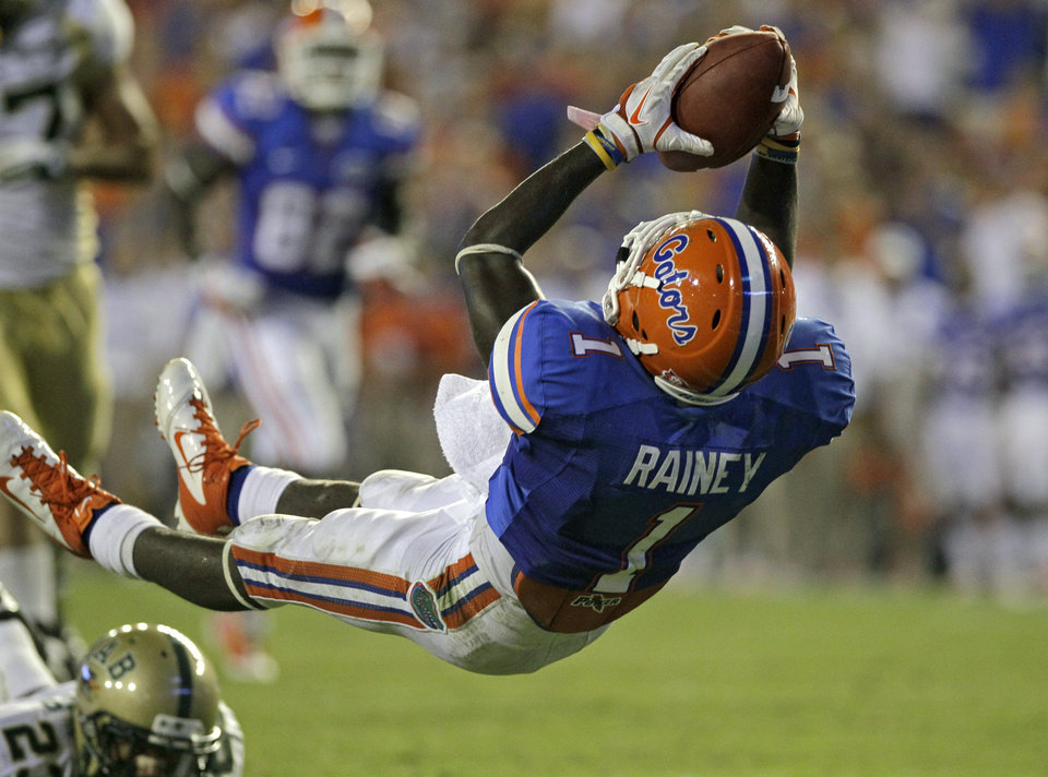 Florida running back Chris Rainey (1) dives backward in the end zone after scoring a touchdown on a 19-yard run against UAB during the second half of an NCAA college football game Saturday, Sept. 10, 2011, in Gainesville, Fla. (AP Photo/John Raoux)