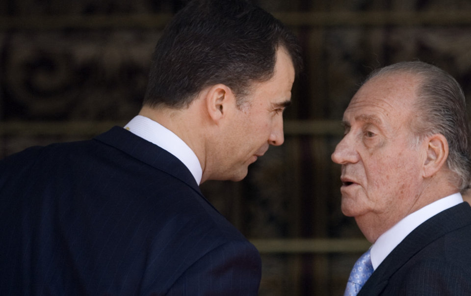 Photo - FILE - In this Wednesday, April 16, 2008, file photo, Spain's Crown Prince Felipe talks with his father Spain's King Juan Carlos, during a ceremony on their arrival for the opening of the Spanish Parliament in Madrid. Spanish Prime Minister Mariano Rajoy says King Juan Carlos plans to abdicate and pave the way for his son, Crown Prince Felipe, to become the country's next king. The 76-year-old Juan Carlos oversaw his country's transition from dictatorship to democracy but has had repeated health problems in recent years. His popularity also dipped following royal scandals, including an elephant-shooting trip he took in the middle of Spain's financial crisis that tarnished the monarch's image. The king came to power in 1975, two days after the death of longtime dictator Francisco Franco. (AP Photo/Daniel Ochoa de Olza, File)