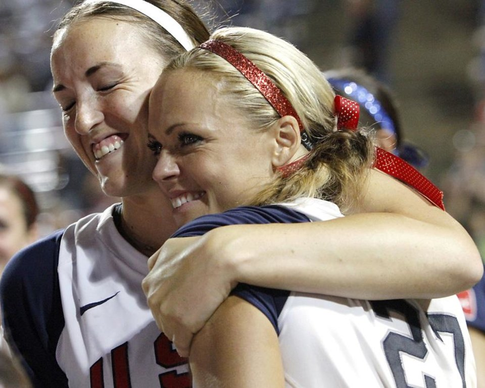 Photo -  USA players Monica Abbott and Jennie Finch embrace during a ceremony after the United States defeated Japan at the World Cup of Softball at ASA Hall of Fame Stadium in Oklahoma City, Monday, July 26, 2010. Photo by John Clanton, The Oklahoman