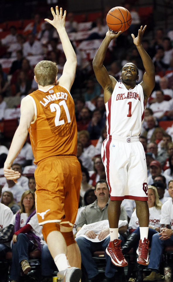 Photo - Oklahoma's Sam Grooms (1) shoots over Texas' Connor Lammert (21) during a men's college basketball game between the University of Oklahoma (OU) and the University of Texas at the Lloyd Noble Center in Norman, Okla., Monday, Jan. 21, 2013. Photo by Nate Billings, The Oklahoman