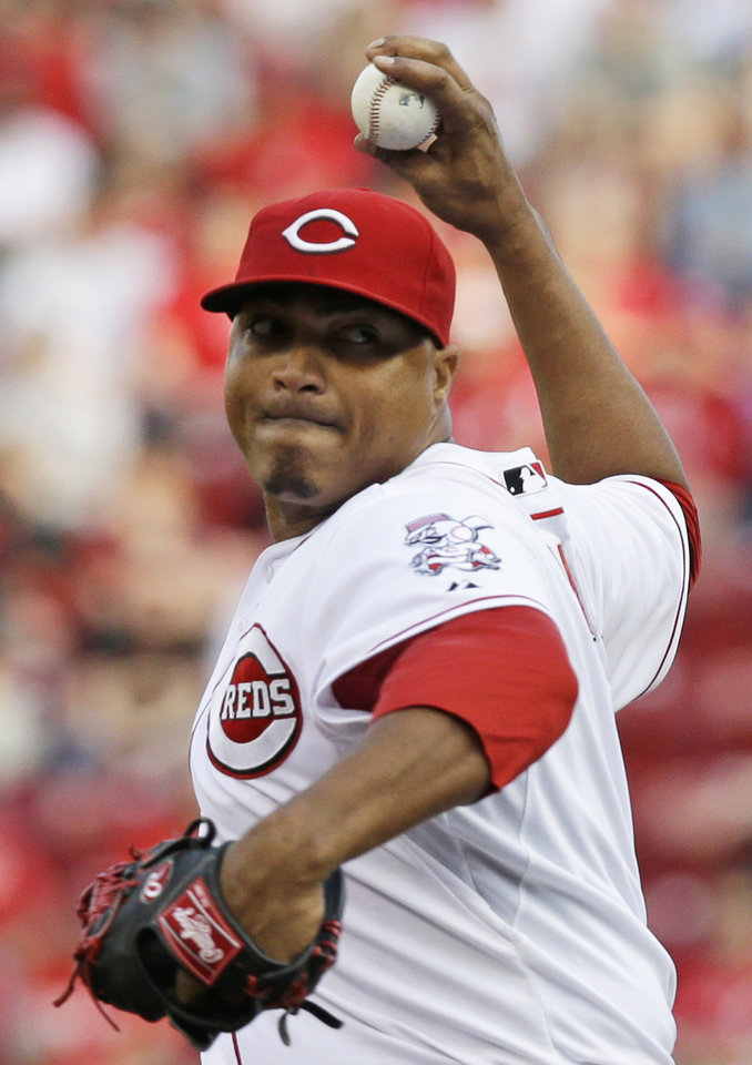 Photo - Cincinnati Reds starting pitcher Alfredo Simon throws against the Colorado Rockies in the first inning of a baseball game on Saturday, May 10, 2014, in Cincinnati. (AP Photo/Al Behrman)