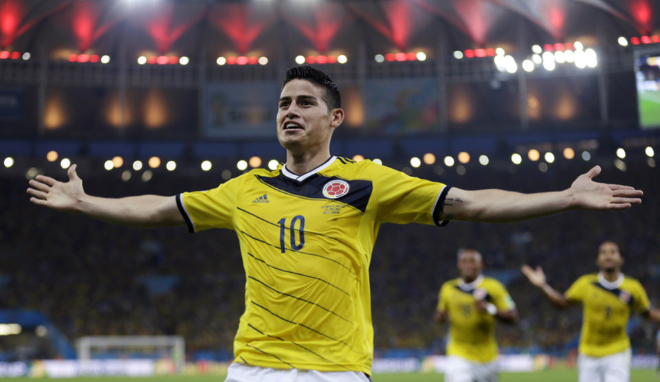Photo - FILE - In this June 28, 2014, file photo, Colombia's James Rodriguez celebrates after scoring the opening goal during the World Cup round of 16 soccer match between Colombia and Uruguay at the Maracana Stadium in Rio de Janeiro, Brazil. Never before has the star-crossed nation made the quarterfinals. There is even waxing poetic about World Cup unity accelerating the pace of 18-month-old peace talks to end a half-century of conflict that has claimed some 220,000 lives. (AP Photo/Natacha Pisarenko)