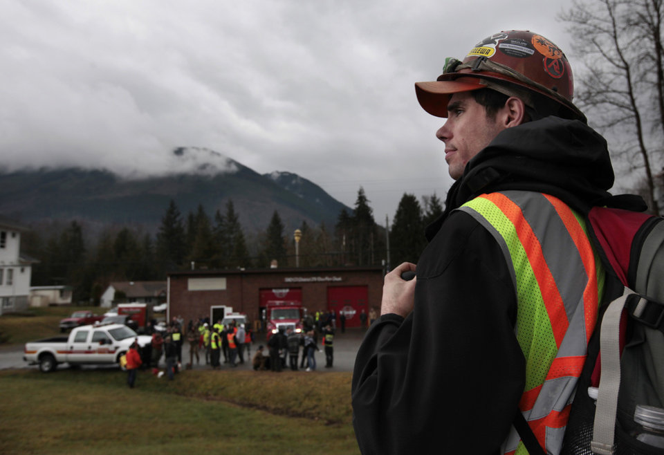 Photo - Derek Stephani, of Federal Way, an electrician, drove up to volunteer to find slide victims in Oso, Wash., Tuesday, March 25, 2014, when he heard the call on the radio. Stephani, who mountaineers and has been helped by search and rescue personnel in an emergency in the past, wanted to come up and do whatever he could to aid the effort. A massive mudslide struck near Arlington, Wash., on Saturday, killing at least 14 people over the weekend and leaving scores more missing. (AP Photo/The Herald, Mark Mulligan)