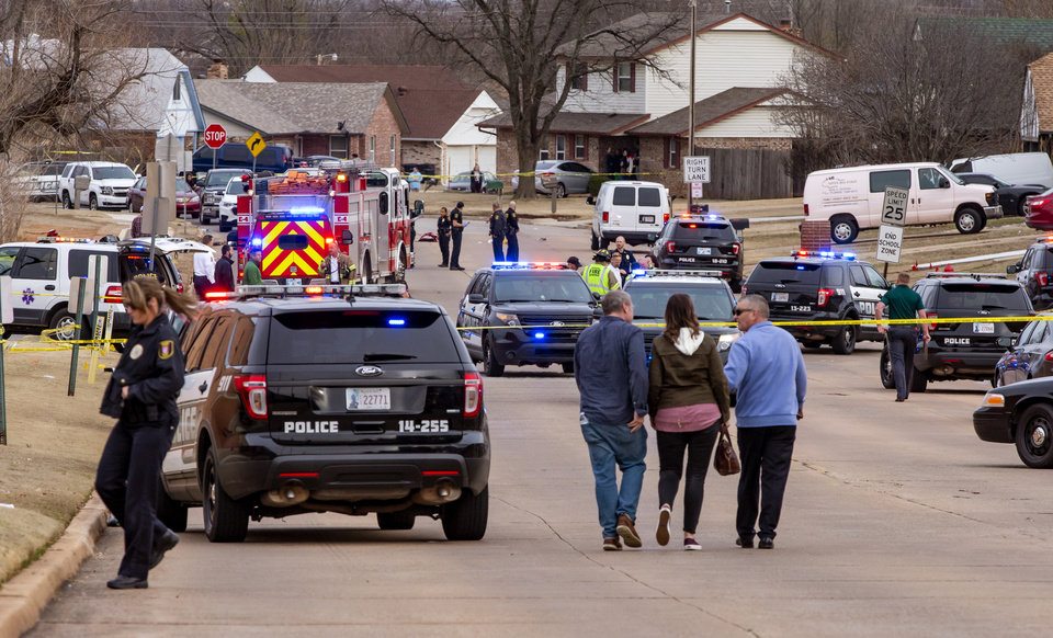 Photo - Emergency crews respond to a scene where six Moore High School students were hit by a truck killing one in Moore, Okla. on Monday, Feb. 3, 2020.  [Chris Landsberger/The Oklahoman]