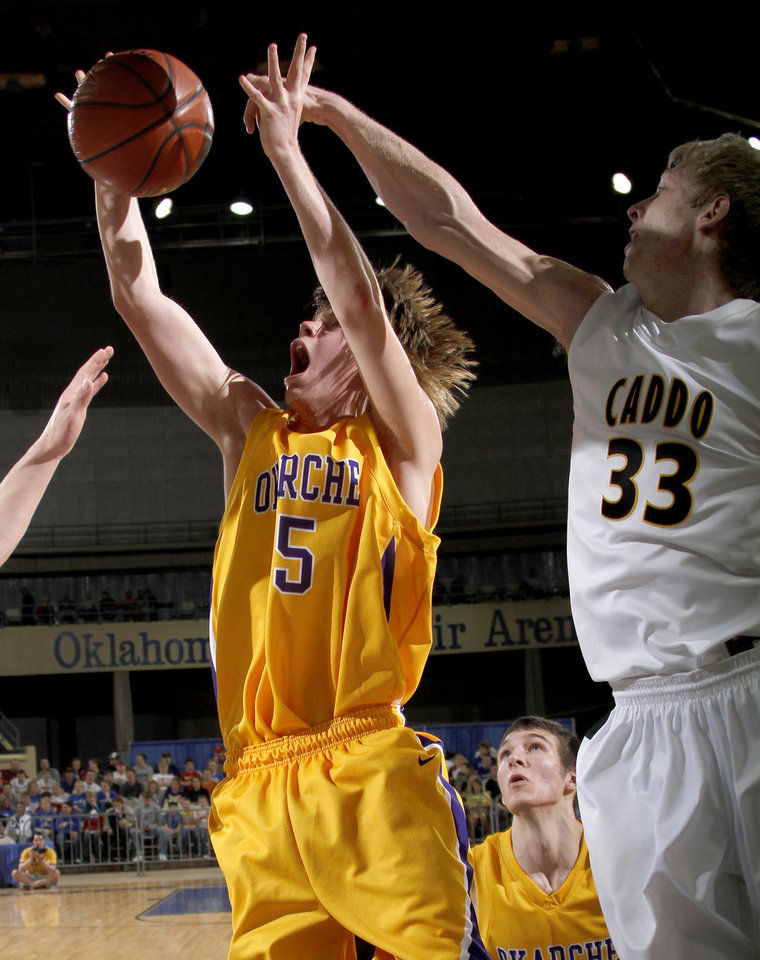 Photo - Okarche's Jabe Karr goes to the basket in front of Caddo's Chris Eastwood during the Class A boys basketball state tournament at the State Fair Arena in Oklahoma City, Friday, March 5, 2010.  Photo by Bryan Terry, The Oklahoman