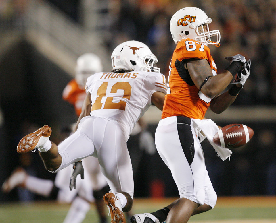 Photo - Cowboy Tracy Moore (87) misses a pass while Earl Thomas (12) of Texas covers during the college football game between the Oklahoma State University Cowboys (OSU) and the University of Texas Longhorns (UT) at Boone Pickens Stadium in Stillwater, Okla., Saturday, Oct. 31, 2009. Photo by Nate Billings, The Oklahoman