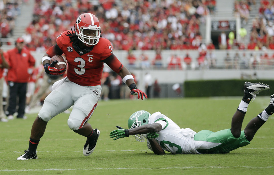 Photo -   GEORGIA     * Coach:  Mark Richt    * 2013 model:  Season-opening loss to Clemson put Bulldogs on mediocre 8-5 track    * Strengths:  Tailback Todd Gurley leads a stable of capable runners and receivers   * Weaknesses:  Special teams were a disaster in 2013    * Key dates: Aug. 30 at home vs. Clemson, Sept. 13 at South Carolina, Nov. 15 at home against Auburn    * Outlook:  Can Georgia survive opening two games?         PHOTO BY THE ASSOCIATED PRESS