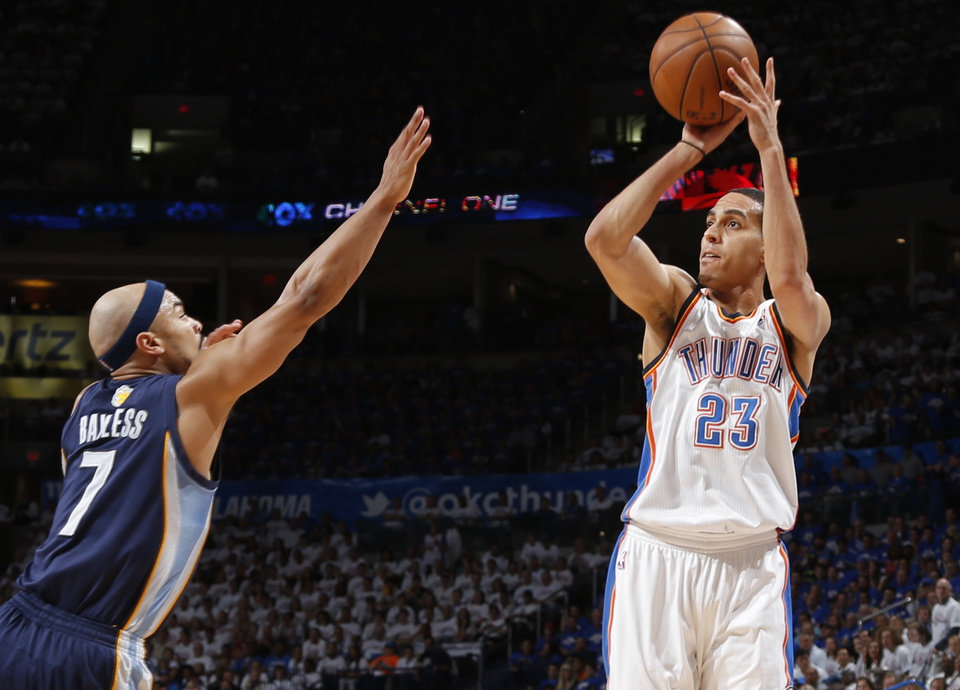 Oklahoma City\'s Kevin Martin shoots the ball over Memphis\' Jerryd Bayless during Game 2 in the second round of the NBA playoffs between the Oklahoma City Thunder and the Memphis Grizzlies at Chesapeake Energy Arena In Oklahoma City, Tuesday, May 7, 2013. Photo by Bryan Terry, The Oklahoman
