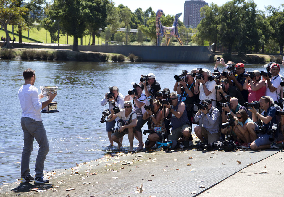 Photo - Switzerland's Stanislas Wawrinka poses for photographers with his Australian Open trophy on the banks of the Yarra River following his win over Spain's Rafael Nadal on Sunday evening in Melbourne, Australia, Monday, Jan. 27, 2014. (AP Photo/Mark Baker)