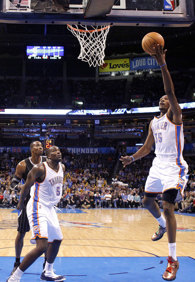 Oklahoma City Thunder's Kevin Durant (35) shoots a lay up during the opening day NBA basketball game between the Oklahoma CIty Thunder and the Orlando Magic at Chesapeake Energy Arena in Oklahoma City, Sunday, Dec. 25, 2011. Photo by Sarah Phipps, The Oklahoman