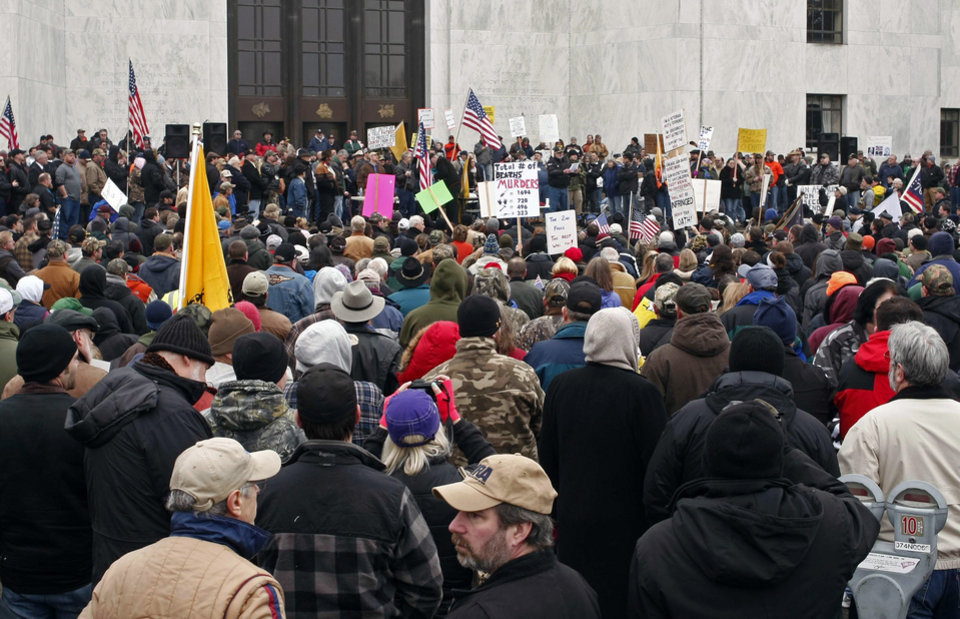 Supporters of the Second Amendment attend a gun rally on the steps of the state Capitol in Salem, Ore., to protest legislation regarding gun laws on Saturday Jan. 19, 2013. (AP Photo/Statesman-Journal, Timothy J. Gonzalez)
