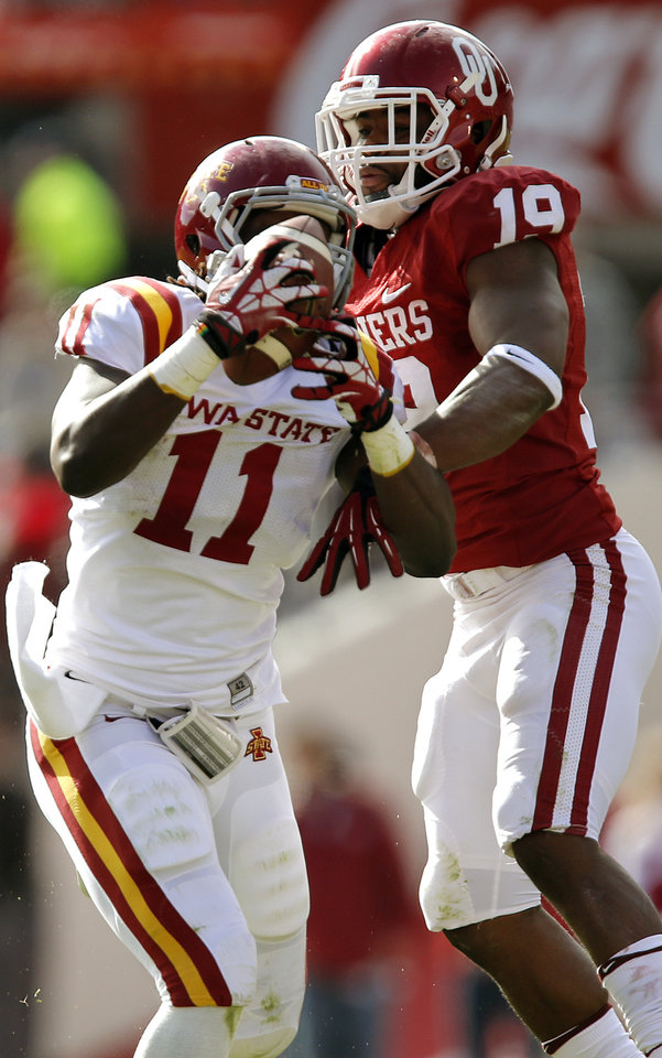 Oklahoma\'s Eric Striker (19) tries to defend a pass on Iowa State\'s E.J. Bibbs (11) during the college football game between the University of Oklahoma Sooners (OU) and the Iowa State University Cyclones (ISU) at Gaylord Family-Oklahoma Memorial Stadium in Norman, Okla. on Saturday, Nov. 16, 2013. Photo by Chris Landsberger, The Oklahoman
