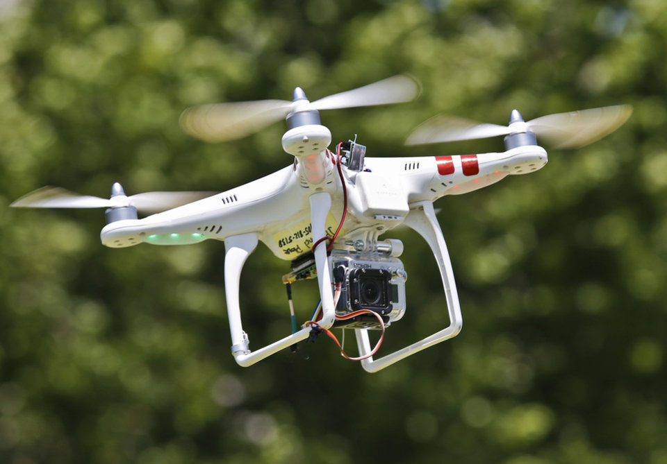 Photo - Price Edwards & Co.'s drone is shown in flight.  CHRIS LANDSBERGER - THE OKLAHOMAN