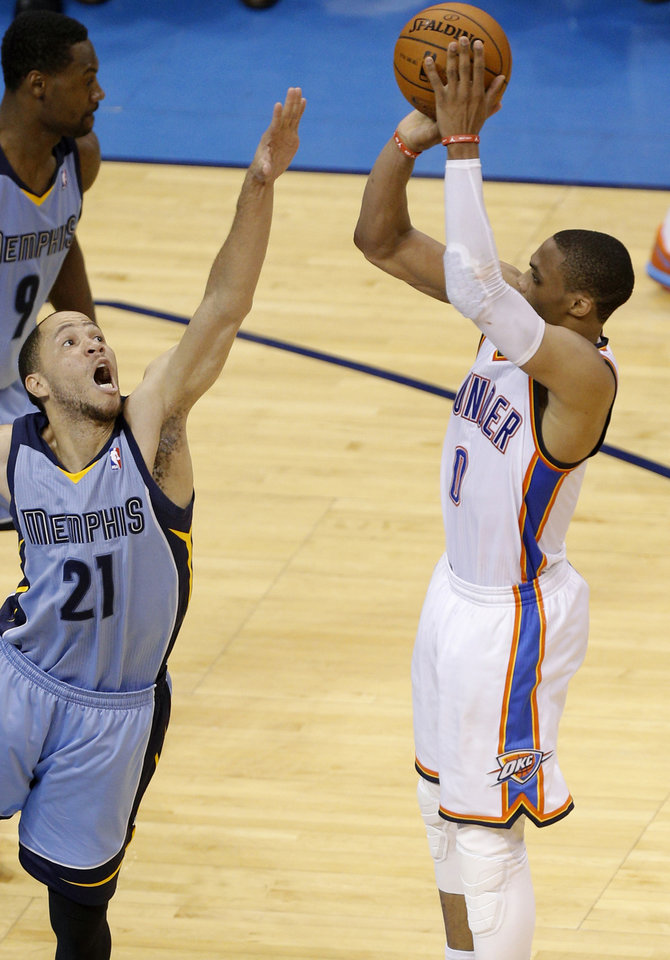 Photo - Oklahoma City's Russell Westbrook (0) shoots over Memphis' Tayshaun Prince (21) during Game 7 in the first round of the NBA playoffs between the Oklahoma City Thunder and the Memphis Grizzlies at Chesapeake Energy Arena in Oklahoma City, Saturday, May 3, 2014. Photo by Sarah Phipps, The Oklahoman