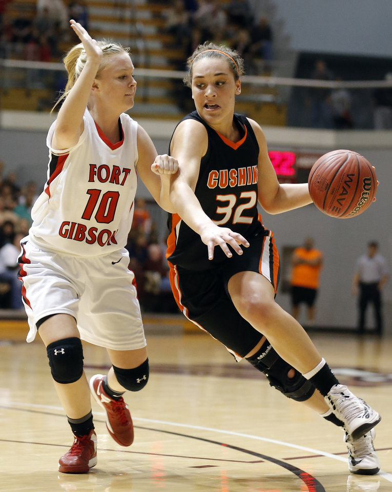 Cushing's Taylor Jones drives past Fort Gibson's Taylor London during the 4A girls high school basketball game in the semifinals of the state tournament between Cushing and Fort Gibson at Southern Nazarene University in Oklahoma City, Friday, March 8, 2013. Photo by Sarah Phipps, The Oklahoman