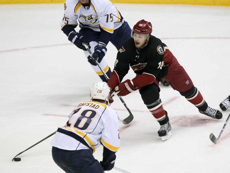 Phoenix Coyotes right wing Shane Doan (19) carries the puck in the second period against the Nashville Predators during an NHL hockey game on Monday, Jan. 28, 2013, in Glendale, Ariz. (AP Photo/Rick Scuteri)