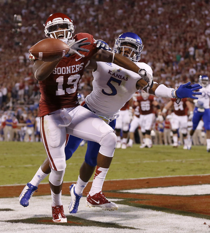 OU's Justin Brown (19) can't make the catch beside KU's Greg Brown (5) during the college football game between the University of Oklahoma Sooners (OU) and the Kansas Jayhawks (KU) at Gaylord Family-Oklahoma Memorial Stadium in Norman, Okla., Saturday, Oct. 20, 2012. Photo by Bryan Terry, The Oklahoman