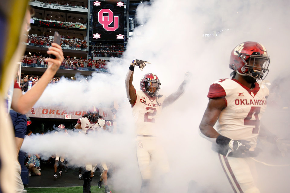Photo - Oklahoma's CeeDee Lamb (2) takes the field before the Big 12 Championship football game between the Oklahoma Sooners (OU) and the Texas Longhorns (UT) at AT&T Stadium in Arlington, Texas, Saturday, Dec. 1, 2018.  Oklahoma won 39-27. Photo by Bryan Terry, The Oklahoman