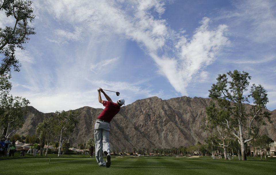 Photo - Patrick Reed hits his tee shot on fourth hole during the final round of the Humana Challenge golf tournament on the Palmer Private course at PGA West, Sunday, Jan. 19, 2014, in La Quinta, Calif. (AP Photo/Chris Carlson)