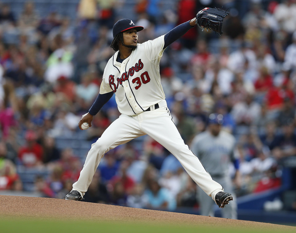 Photo - Atlanta Braves starting pitcher Ervin Santana works in the first inning of a baseball game against the Chicago Cubs, Saturday, May 10, 2014 in Atlanta. (AP Photo/John Bazemore)